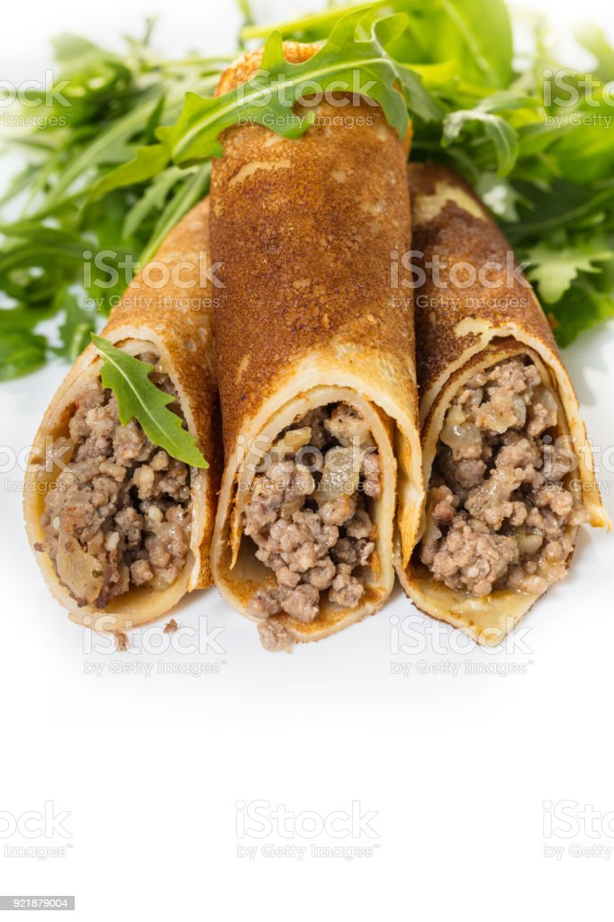 pancakes with meat stuffing and salad stock photo