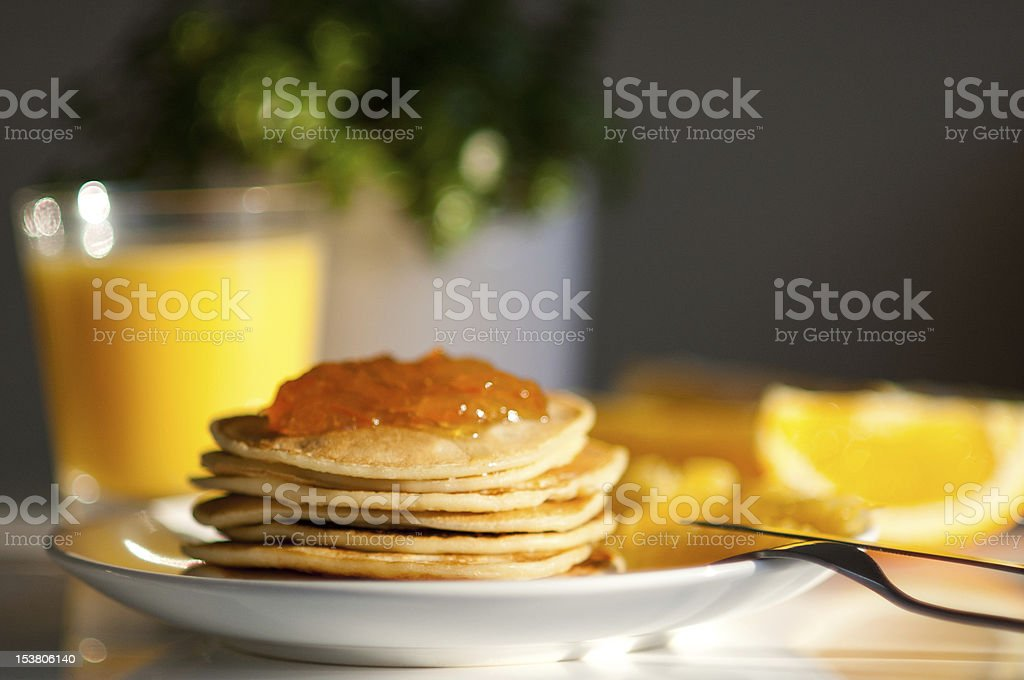 Pancakes with orange jam royalty-free stock photo