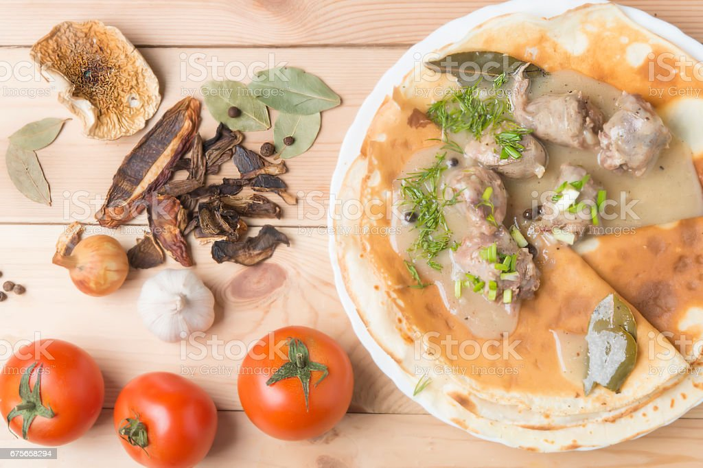 Pancakes with sausage, pepper and mushrooms with fragrant gravy. Home cuisine. royalty-free stock photo
