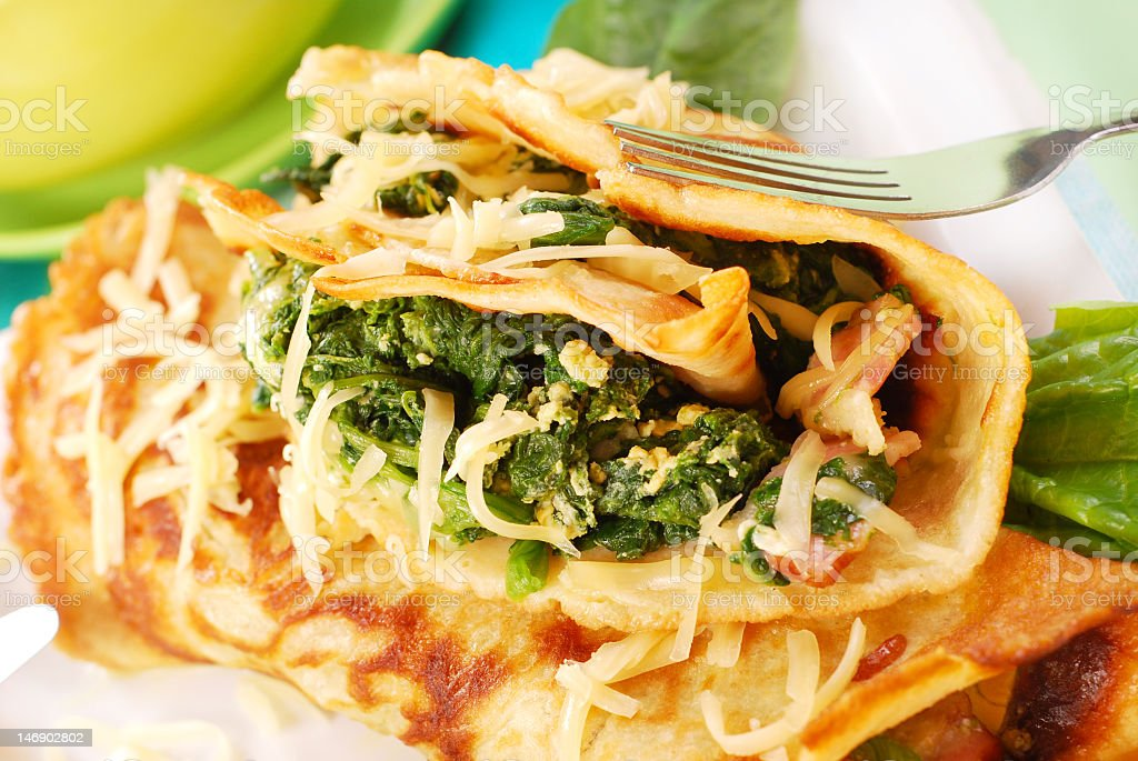 Pancakes with spinach and a fork royalty-free stock photo