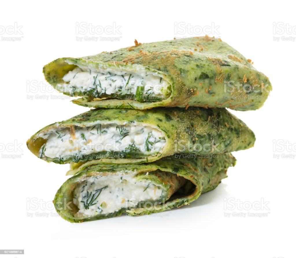 pancakes with spinach and cheese filling stock photo
