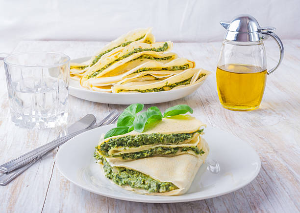 Pancakes with spinach and feta cheese stock photo