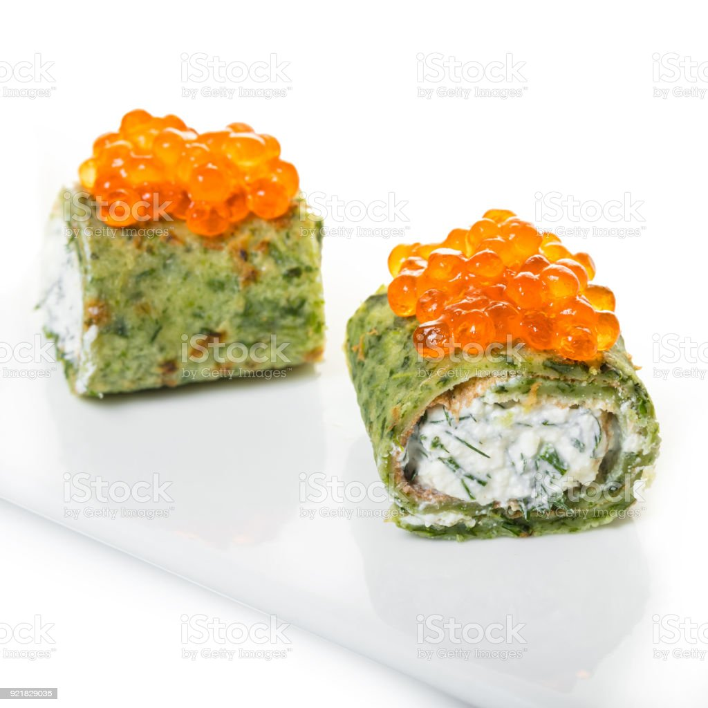 pancakes with spinach and red caviar stock photo