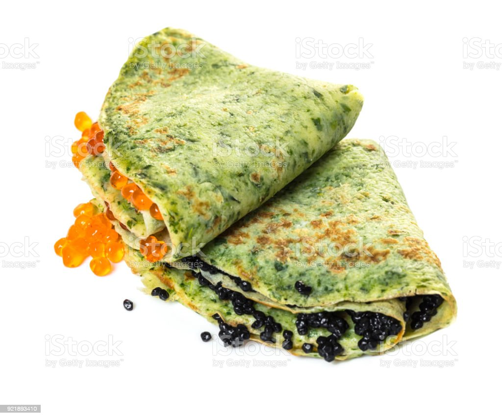 pancakes with spinach filling red and black caviar stock photo