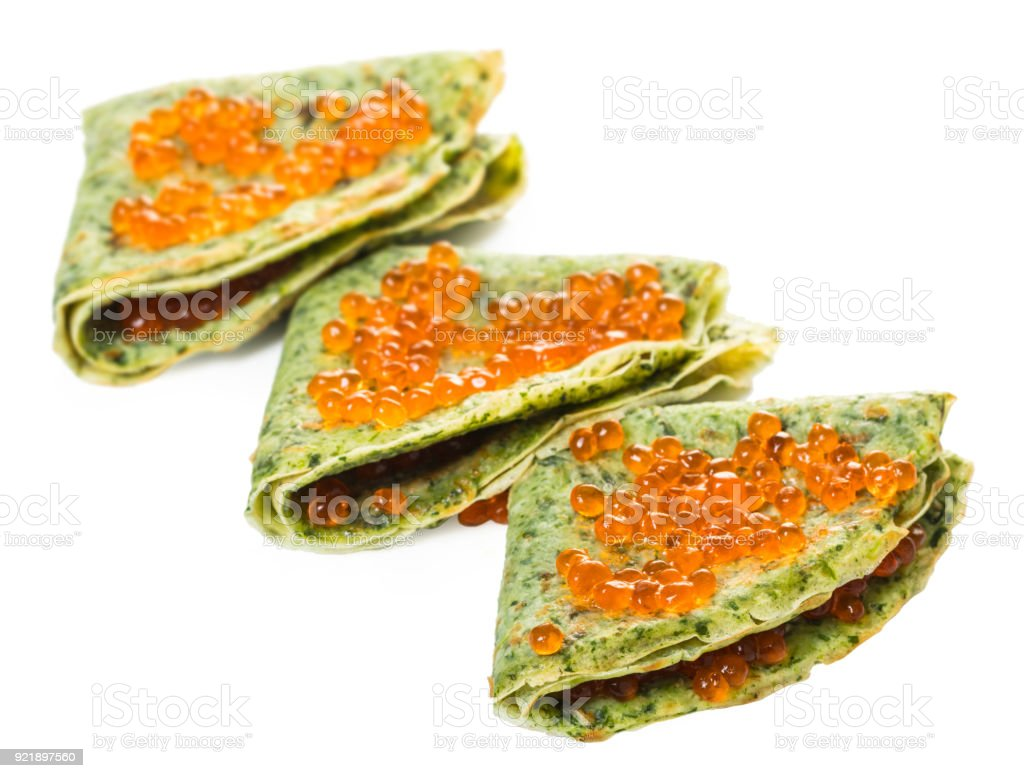 pancakes with spinach  filling red caviar stock photo