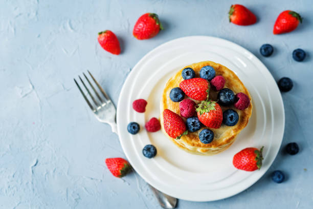 pancakes with strawberries, blueberries and raspberries stock photo