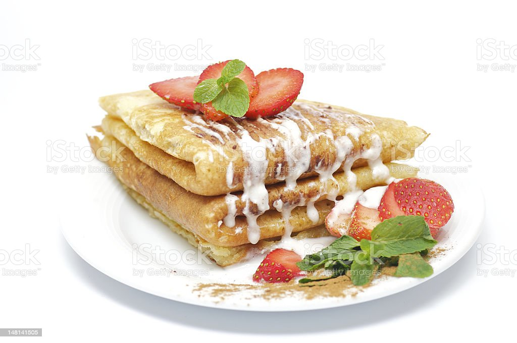 Pancakes with strawberry and Mint leaflets royalty-free stock photo