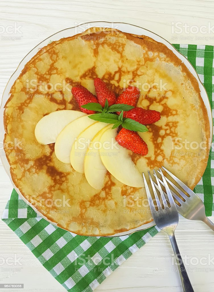 pancakes with strawberry apple mint on white wooden royalty-free stock photo