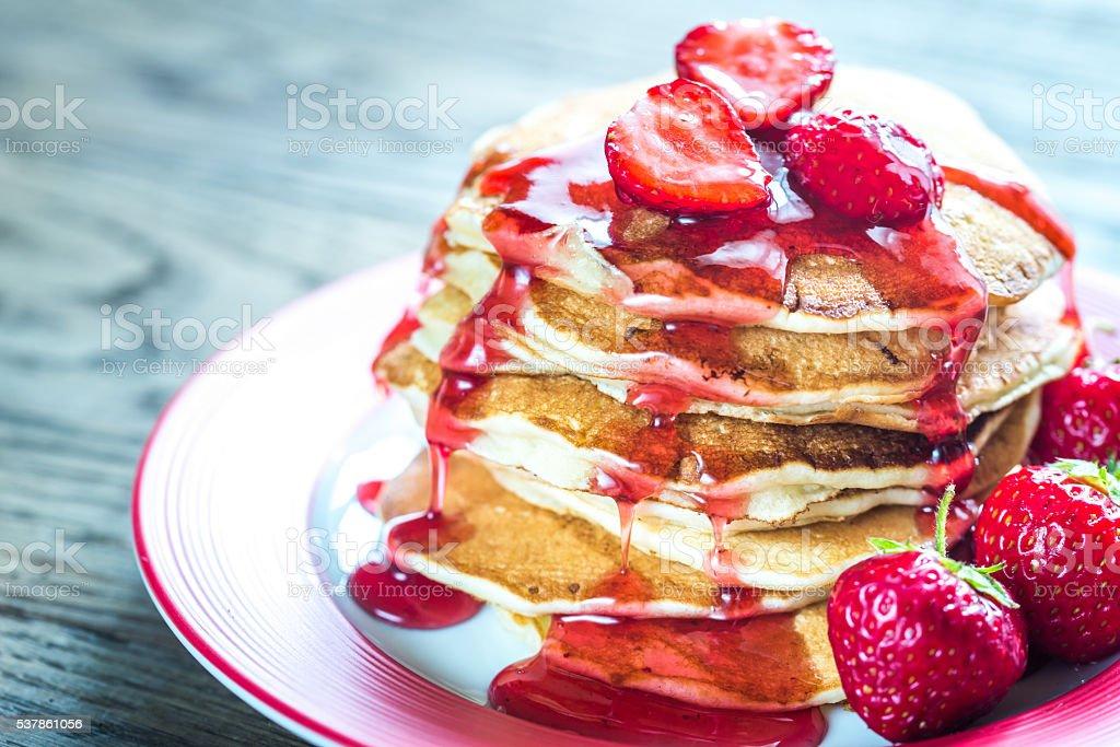 Pancakes with strawberry jam stock photo