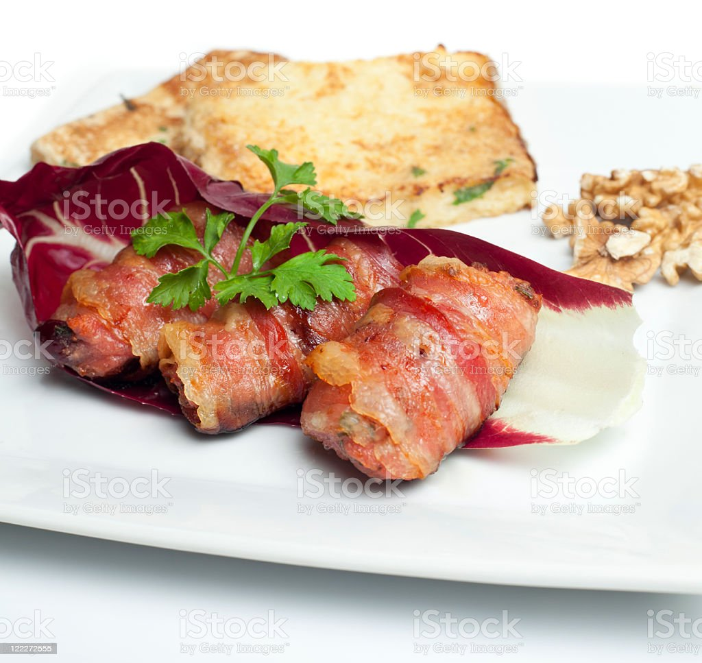 Pancetta wrapped sausages royalty-free stock photo