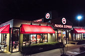 Davis, California, USA- January 27, 2017: Night View of a Panda Express Restaurant at East Cowell Boulevard in Davis, CA. Panda Express is a fast food casual restaurant chain which serves American Chinese cuisine. Panda Express has over 1,900 restaurants, located in USA, Canada, Mexico, Korea, and the United Arab Emirates.