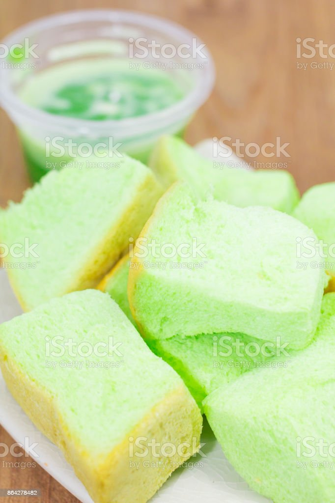 Pandan custard in a dish placed on the wood. royalty-free stock photo