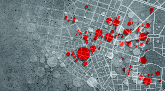 Pandemic clusters background on city map showing red circles overlapping on a dark textured background with copy space