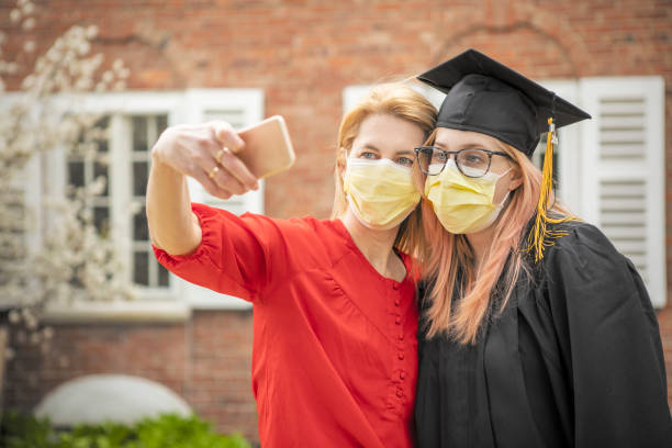 Pandemic Grad Mother and Daughter Selfie stock photo