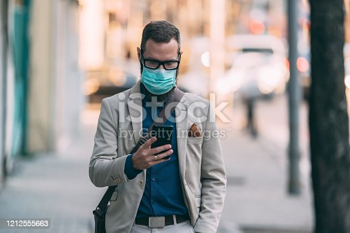 Businessman wearing mask in the city during COVID-19 pandemic