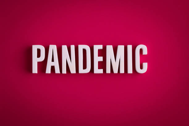 Pandemic sign lettering on a red colored background stock photo