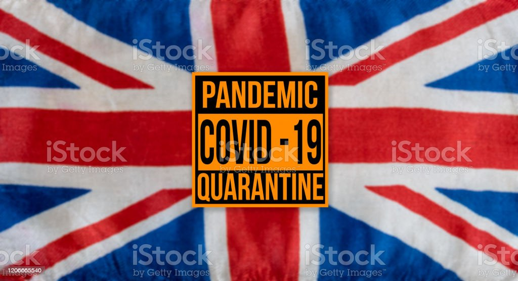 Pandemic sign warning of quarantine due to Covid-19 or corona virus in the UK Pandemic sign warning of quarantine due to Covid-19 or corona virus in the UK using a british flag in the background Accidents and Disasters Stock Photo