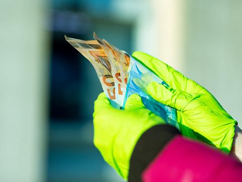 istock pandemic virus causes rationing of cash via ATM 1216439133