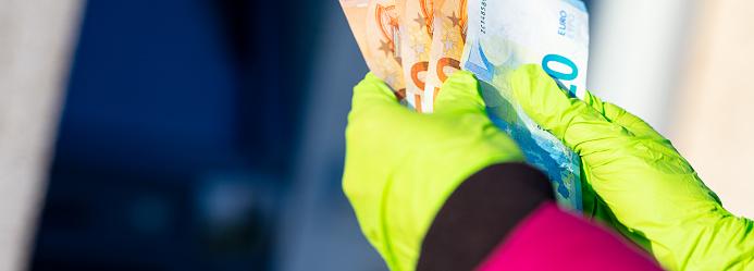 istock pandemic virus causes rationing of cash via ATM 1216439215