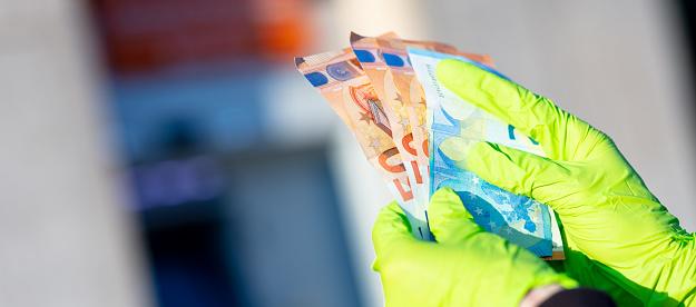 istock pandemic virus causes rationing of cash via ATM 1216439292