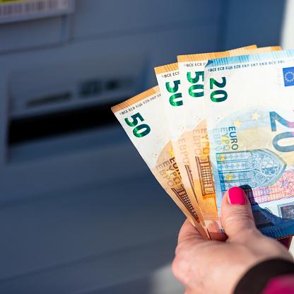 istock pandemic virus causes rationing of cash via ATM 1216439327