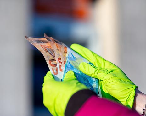 istock pandemic virus causes rationing of cash via ATM 1216439363