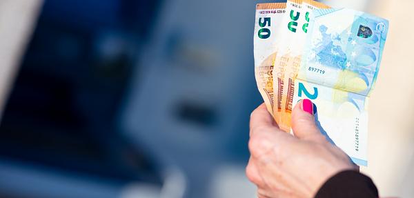 istock pandemic virus causes rationing of cash via ATM 1216439559