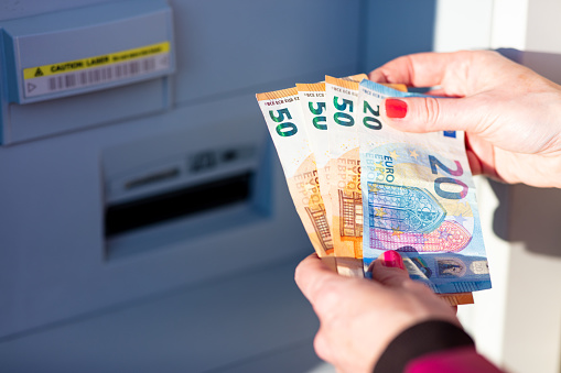 istock pandemic virus causes rationing of cash via ATM 1216439603