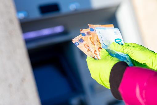 istock pandemic virus causes rationing of cash via ATM 1216439689