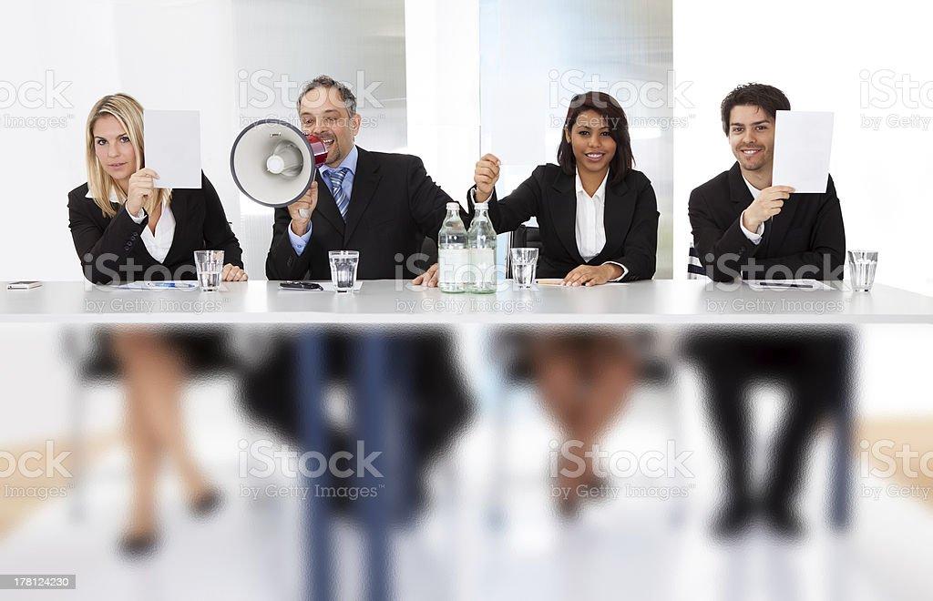Panel judges holding empty score signs stock photo