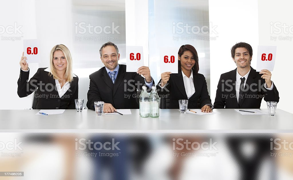 Panel judges holding perfect score signs royalty-free stock photo