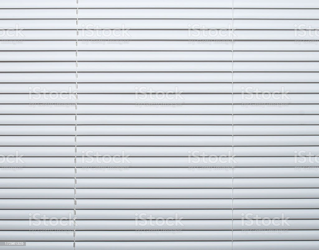 Panel of white window blinds in closed position royalty-free stock photo