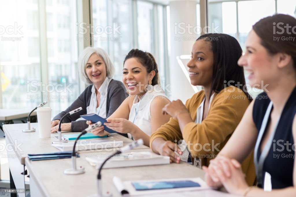 A diverse panel presents information at the yearly university women\'s...