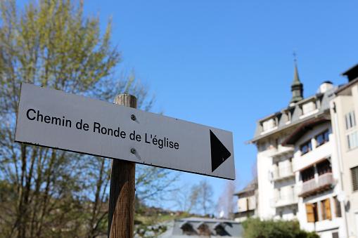 Panel on which is indicated: Chemin de Ronde of the church. Saint-Gervais-les-Bains. Haute-Savoie. Auvergne-Rhône-Alpes. France.