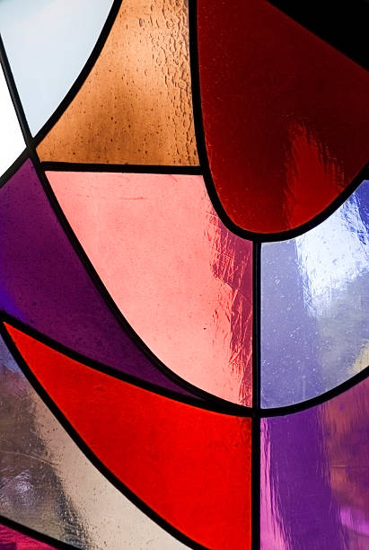 Panels of stained glass in a window stock photo