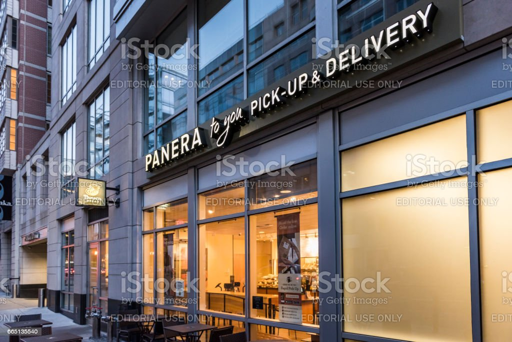 Panera Bread restaurant facade with pick-up and delivery sign stock photo