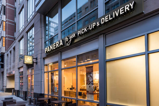 panera bread restaurant facade with pick-up and delivery sign - food logo stock photos and pictures