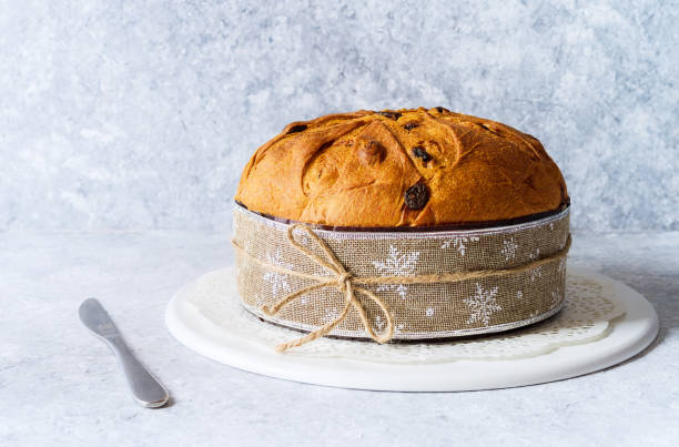 Panettone, typical christmas italian food, on rustic background. - foto stock