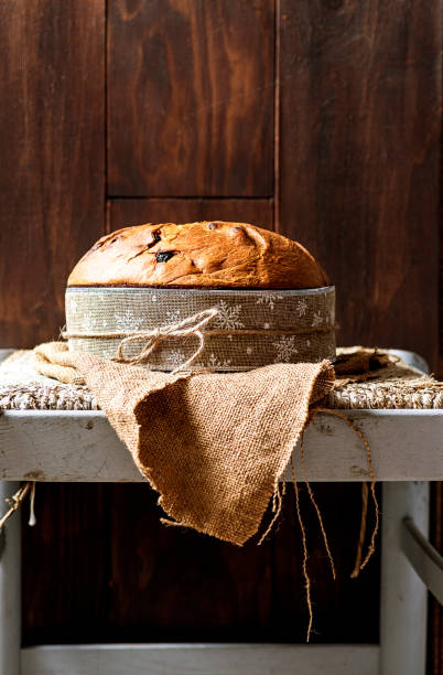 Panettone, typical christmas italian food, on rustic wooden background. - foto stock