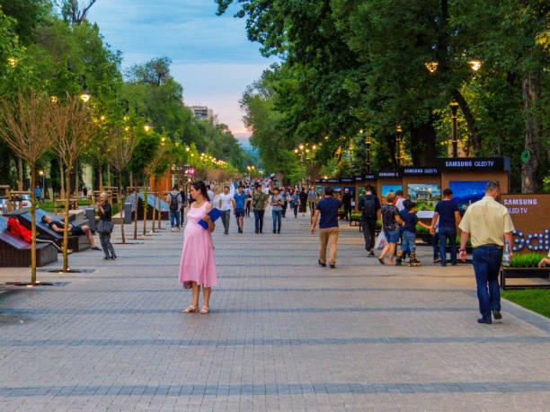 panfilov street, almaty, kazakstan - walking home sunset street bildbanksfoton och bilder