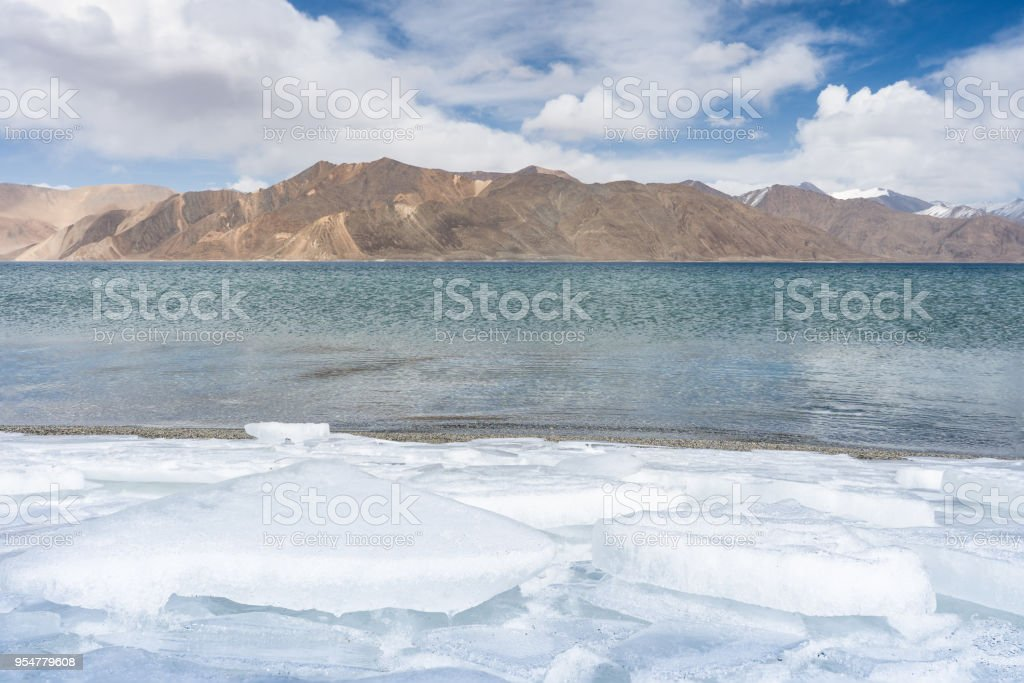 Pangong Lake in early Spring in Leh Ladakh, North India. Pangong Tso is a beautiful endorheic lake situated in the Himalayas extending from India to China stock photo