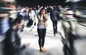 istock Panic attack in public place. Woman having panic disorder in city. Psychology, solitude, fear or mental health problems concept. 1033774292