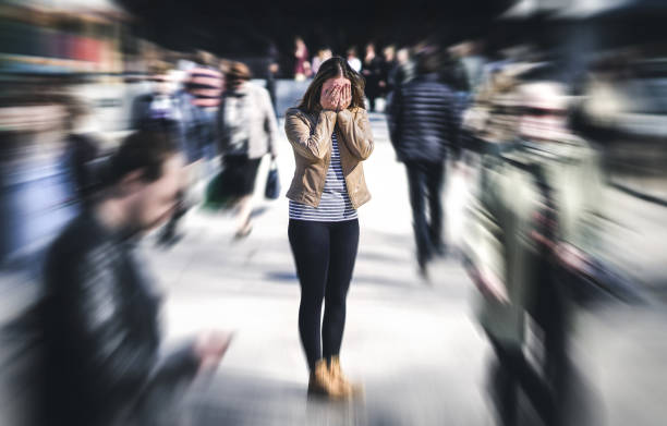 Panic attack in public place. Woman having panic disorder in city. Psychology, solitude, fear or mental health problems concept. stock photo