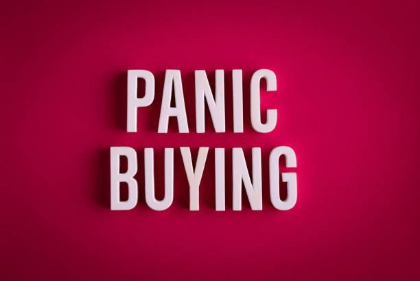 Panic buying sign lettering on a red colored background stock photo