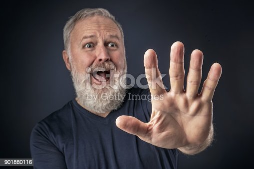 661896674istockphoto Panicked old man with his stretched hand forward 901880116