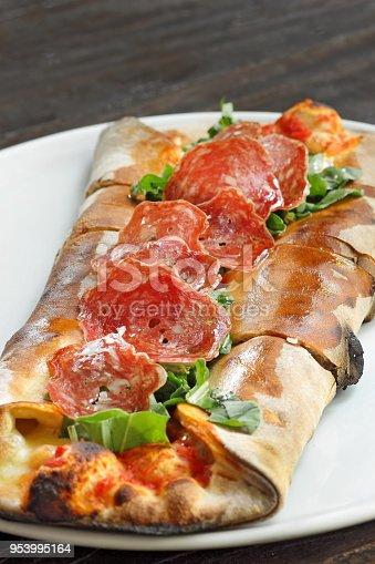 salami, cheese and vegetables panini (italian sandwich)