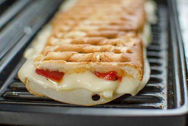 panini-sandwiches italien - kräuterfaltenbrot stock-fotos und bilder