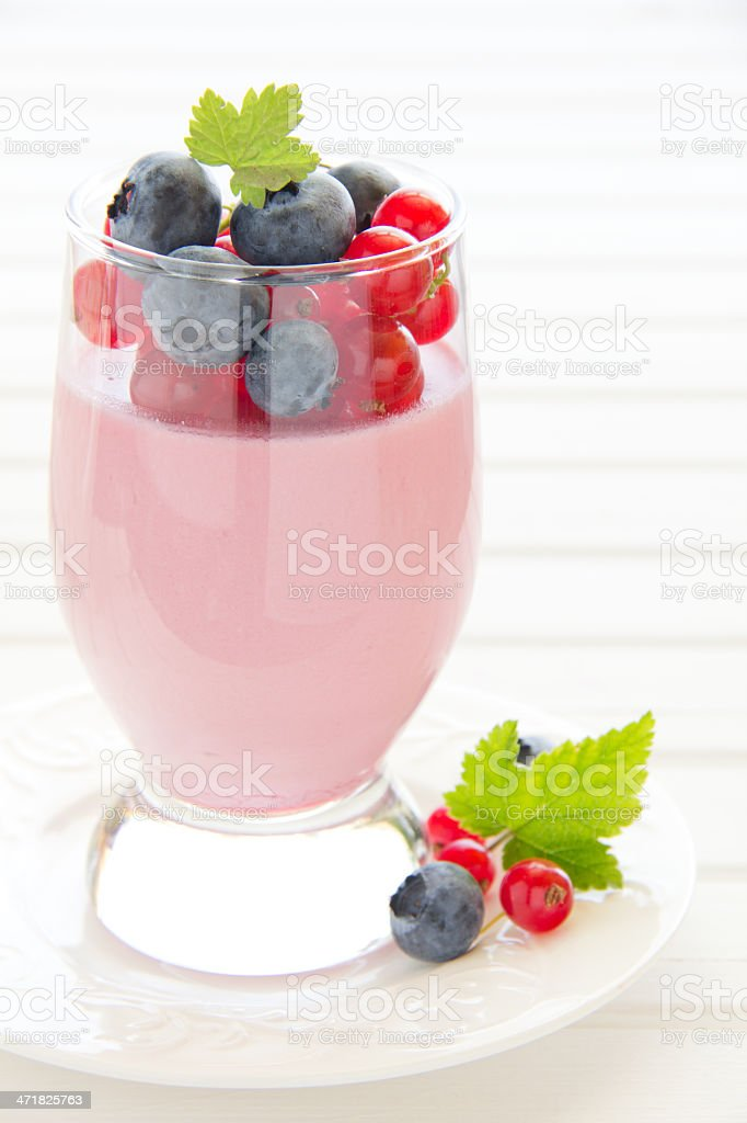 Panna cotta dessert with red currants, selective focus. royalty-free stock photo