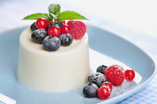 Panna cotta with berries and mint stock photo