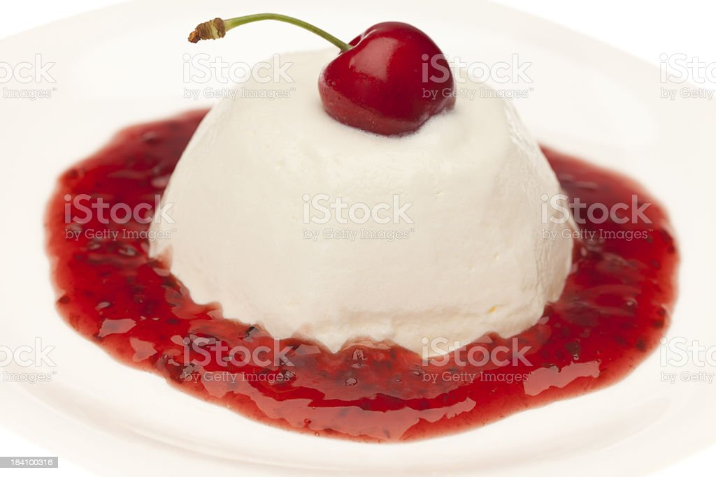 Panna Cotta with cherry topping royalty-free stock photo